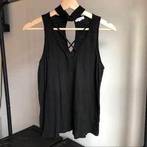 Black tank top with chicken and cross straps